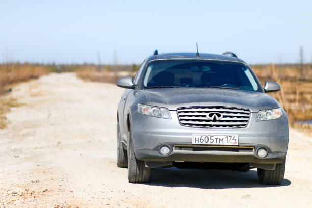 Infiniti FX35 Novyy Urengoy, Russia - June 11, 2018: Dirty crossover Infiniti FX35 at the gravel road. fx network stock pictures, royalty-free photos & images