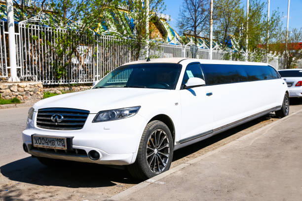Infiniti FX45 Moscow, Russia - March 3, 2018: White limousine Infiniti FX45 in the city street. fx network stock pictures, royalty-free photos & images