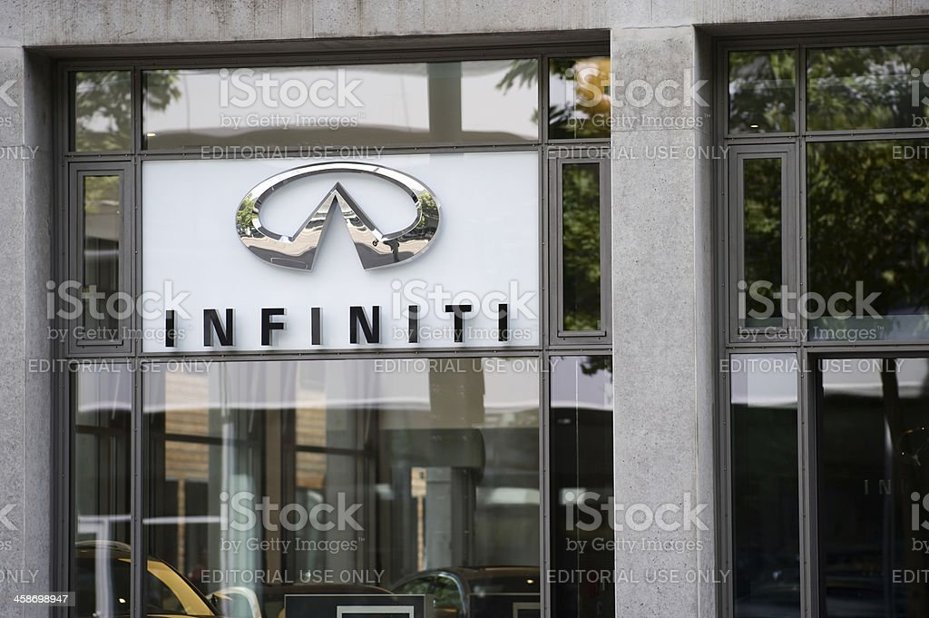 Infiniti logo on car dealer's building stock photo