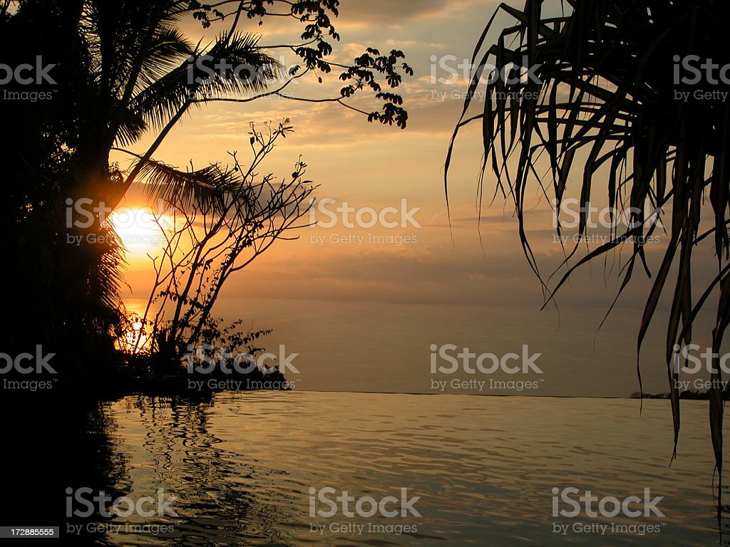 Infinity Pool at Tropical Luxury Resort at Sunset, Costa Rica royalty-free stock photo
