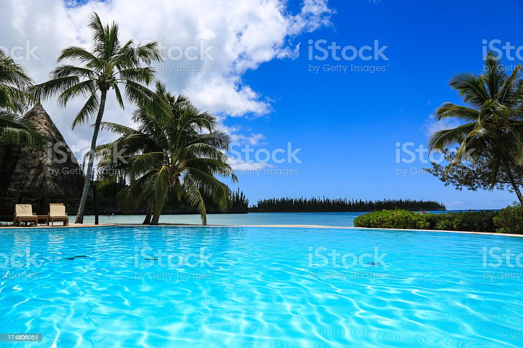 Infinity Pool at Tropical Resort on Perfect Sunny Day stock photo