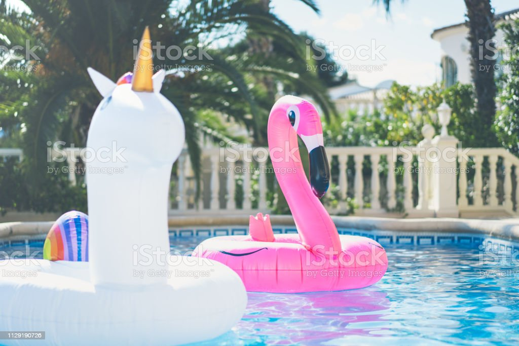 Inflatable Colorful White Unicorn And Pink Flamingo At The ...