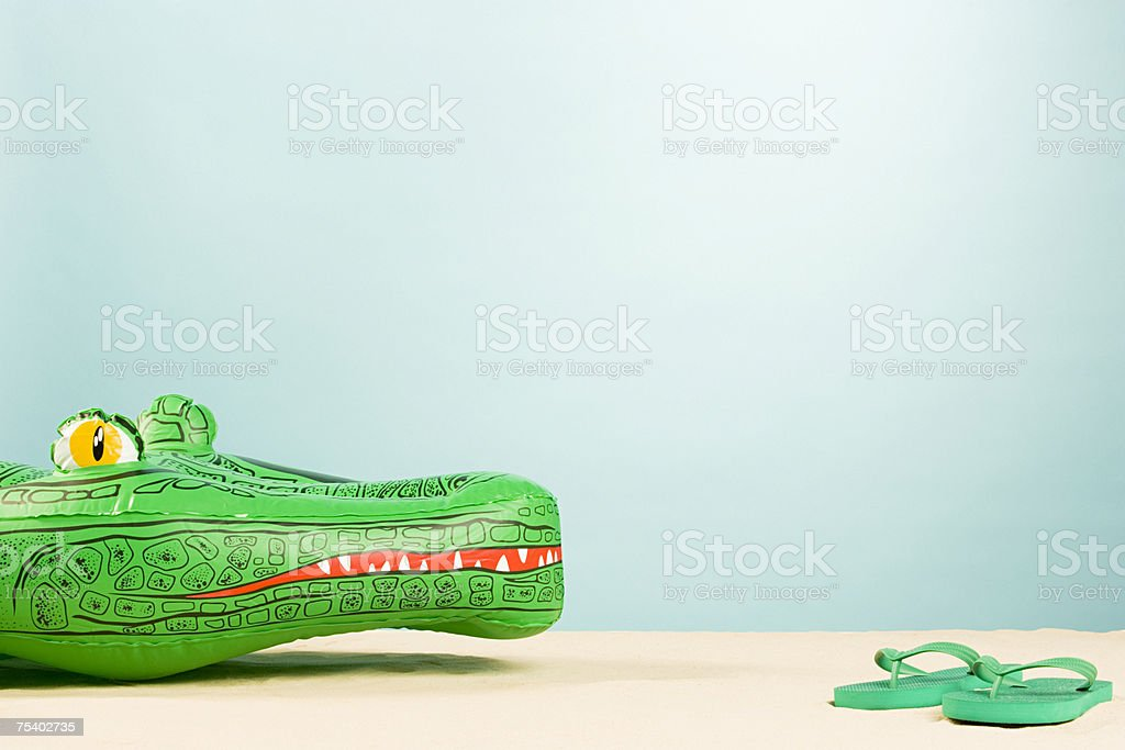 Inflatable crocodile and flip flops foto de stock royalty-free
