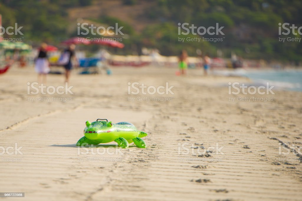 Inflatable crocodile on a sandy beach stock photo