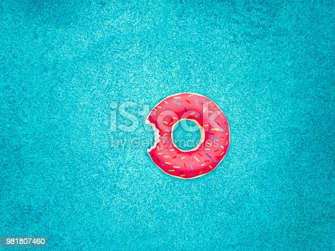 Inflatable donut swimming ring in a swimming pool