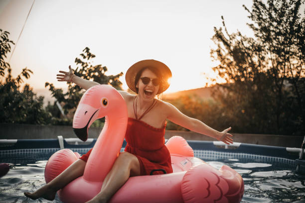 inflatable flamingo - tubing stock pictures, royalty-free photos & images