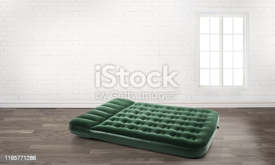 istock inflatable mattress in an empty room 1165771286