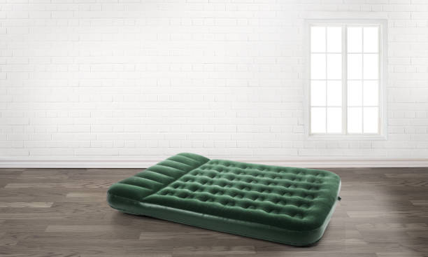 inflatable mattress in an empty room inflatable mattress in an empty room swimming float stock pictures, royalty-free photos & images
