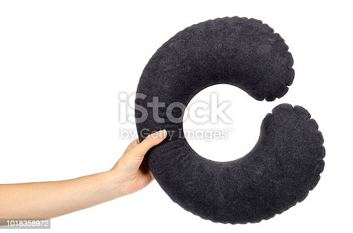 istock Inflatable neck pillow with hand for comfort travel, isolated on white background 1018358972