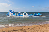 Inflatable playground in the sea at a specialized children's beach of general use in the city of Evpatoria, Crimea, Russia
