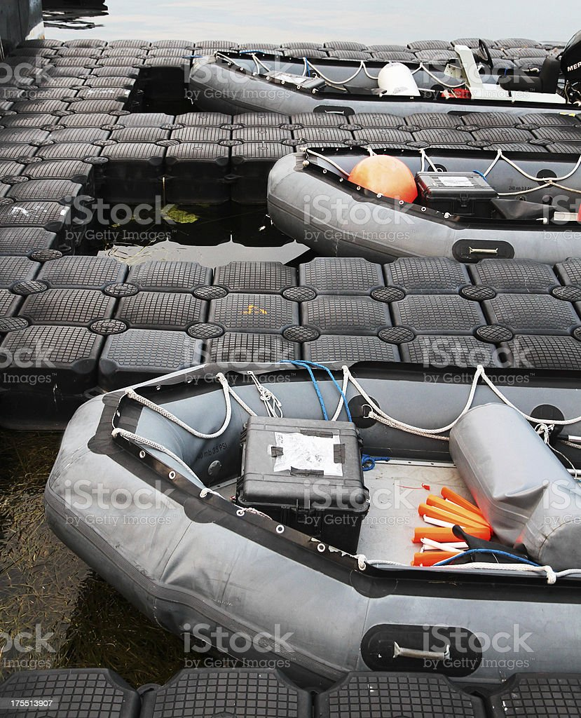 Inflatable pontoon boats and floating dock royalty-free stock photo
