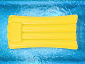 inflatable raft on pool top view