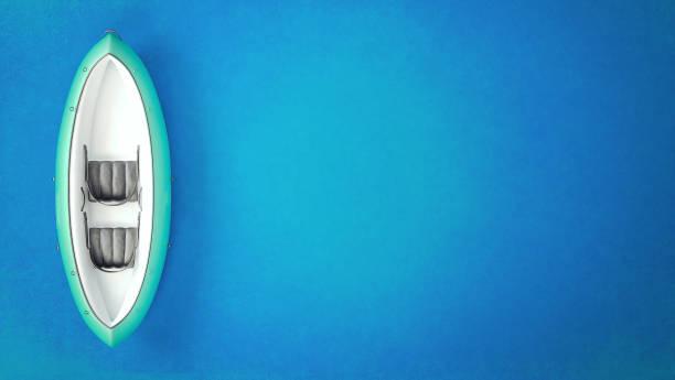 uppblåsbar gummi båts kajak på blå bakgrund - livbåt bildbanksfoton och bilder