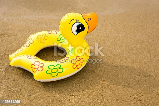 inflatable rubber duck on the beach