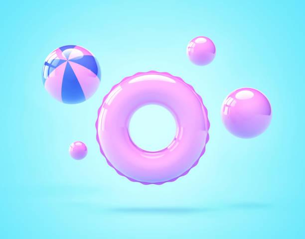 inflatable swimming ring and beach balls - brinquedos na piscina imagens e fotografias de stock