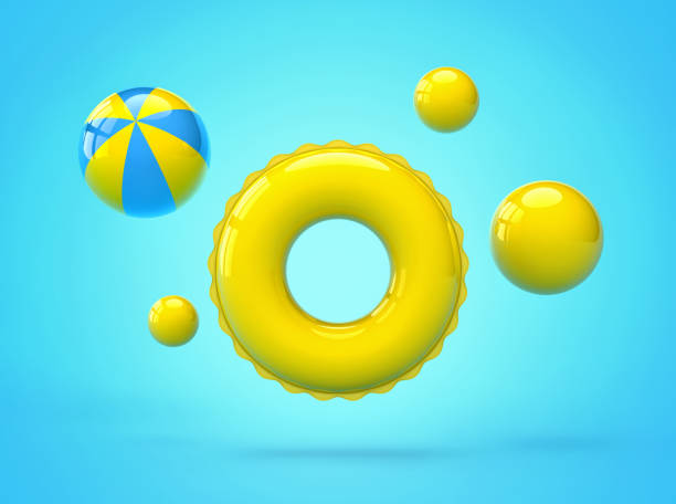 inflatable swimming ring and beach balls - tubing stock pictures, royalty-free photos & images