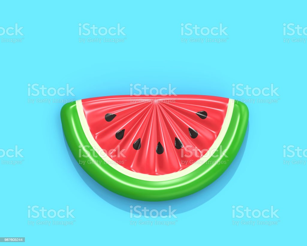 Inflatable watermelon slice on blue background stock photo