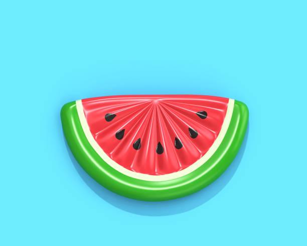 uppblåsbara vattenmelon skiva på blå bakgrund - flotte bildbanksfoton och bilder