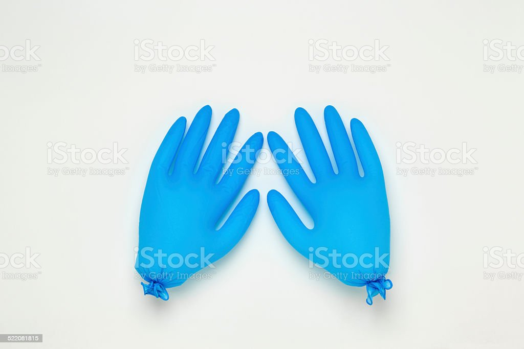 Inflated blue surgical gloves stock photo