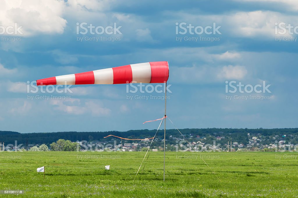 Inflated by the wind weathervane stock photo