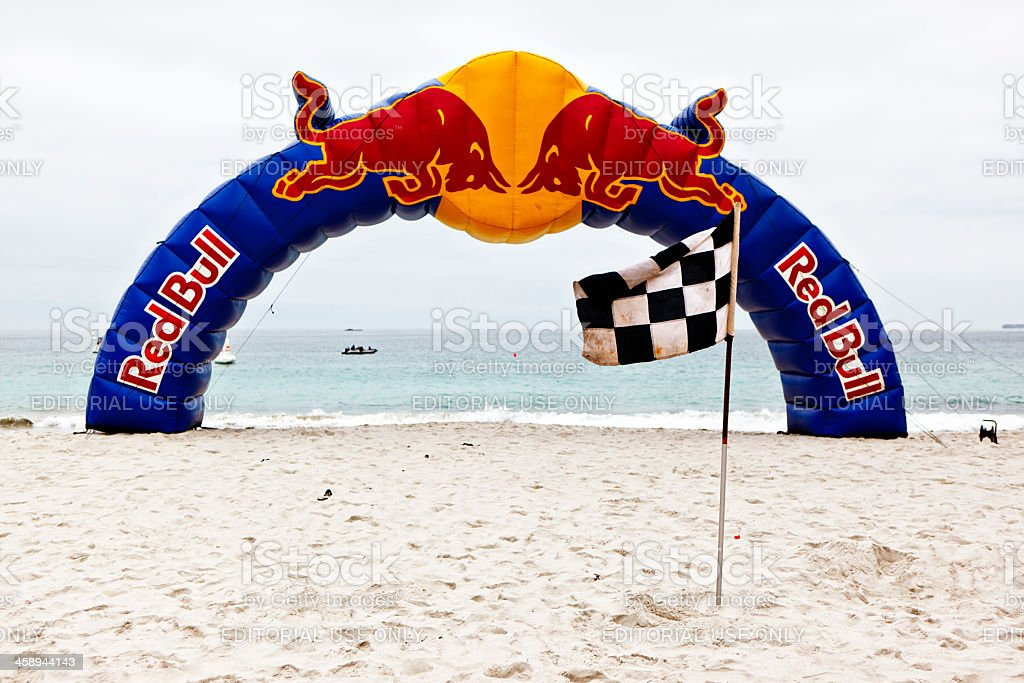 Inflated Red Bull arch and checkered flag showing  finish line royalty-free stock photo