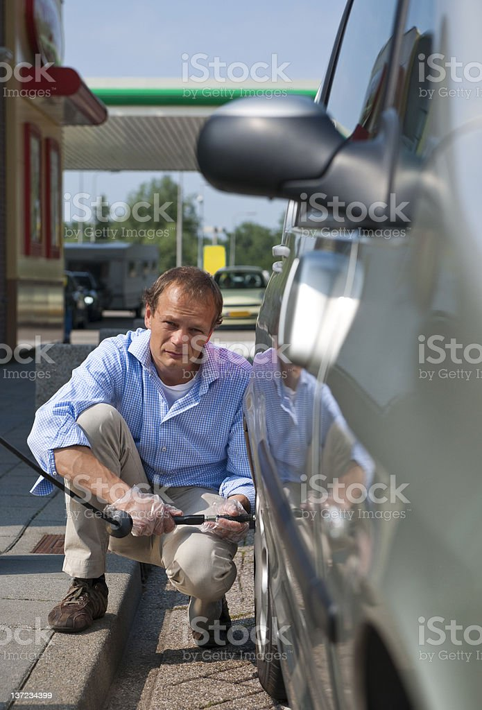 Inflating a tyre royalty-free stock photo