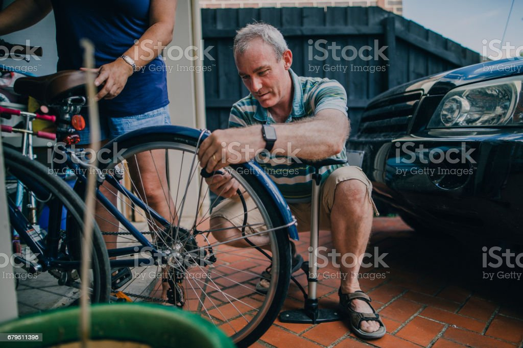 Inflating the Tire on a Bicycle bildbanksfoto