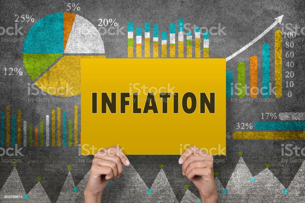 Inflation sign in front of financial report stock photo