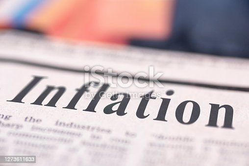 Inflation written newspaper close up shot to the text.