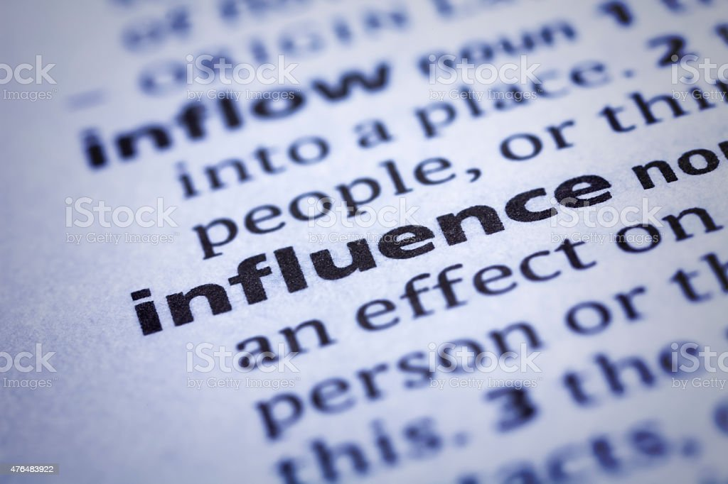 Influence: Dictionary Close-up stock photo