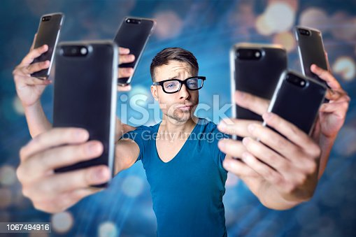 istock Influencer holding an exaggerated number of smartphones 1067494916