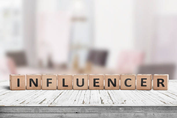 Influencer sign on a wooden table stock photo