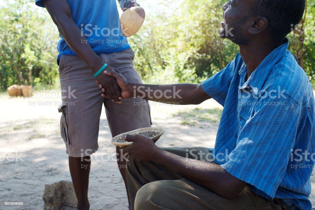 Informal Curios Business transaction handshake stock photo