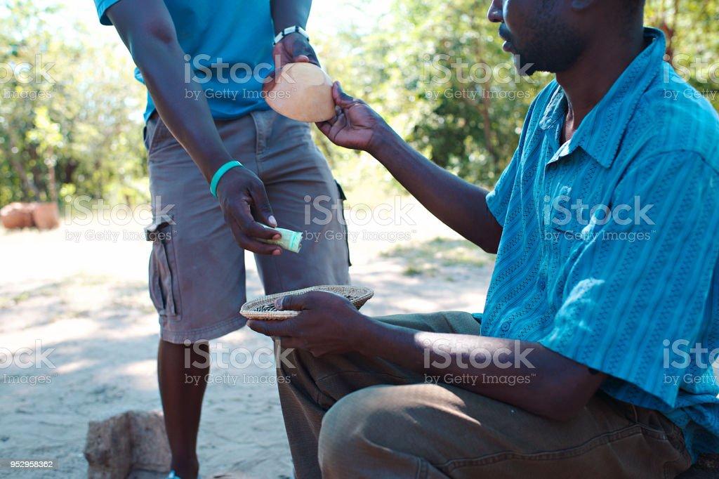 Informal Curios Business transaction outdoors stock photo