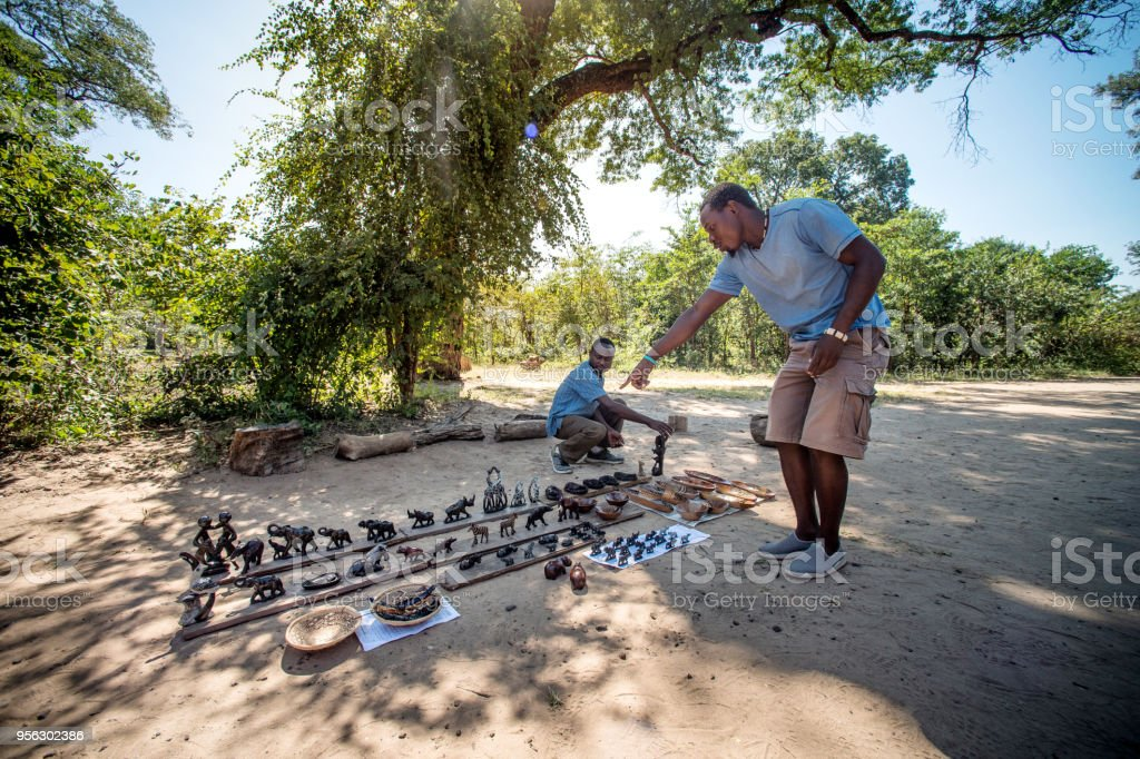 Informal Curios Business under a tree man pointing stock photo