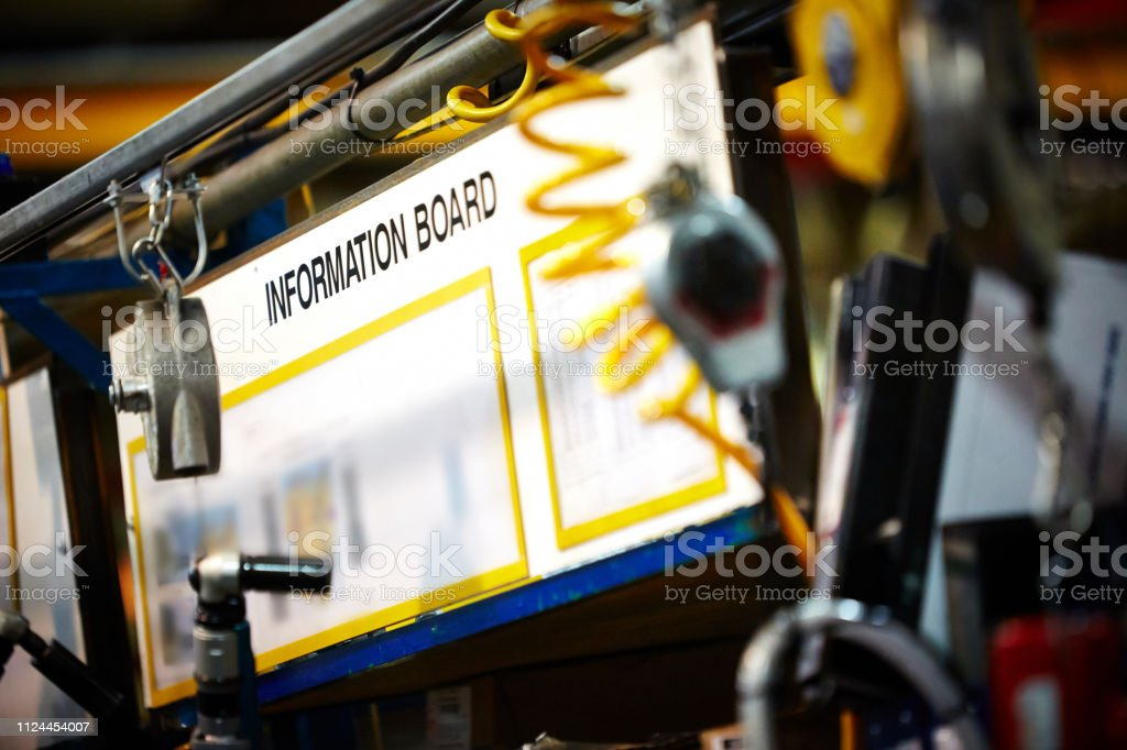 Information board on factory production line stock photo