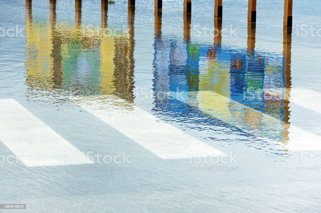 Information boards reflection, water, flooded road in Cerknica, Slovenia, Europe. stock photo