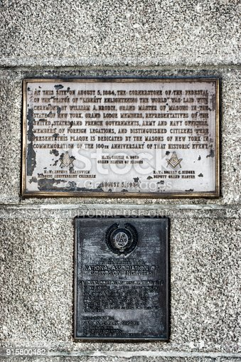 Information Plaques at the base of the plinth under the Statue of Liberty. They have inscriptions thanking the masons of New York and commemorating the work of corrosion engineers.