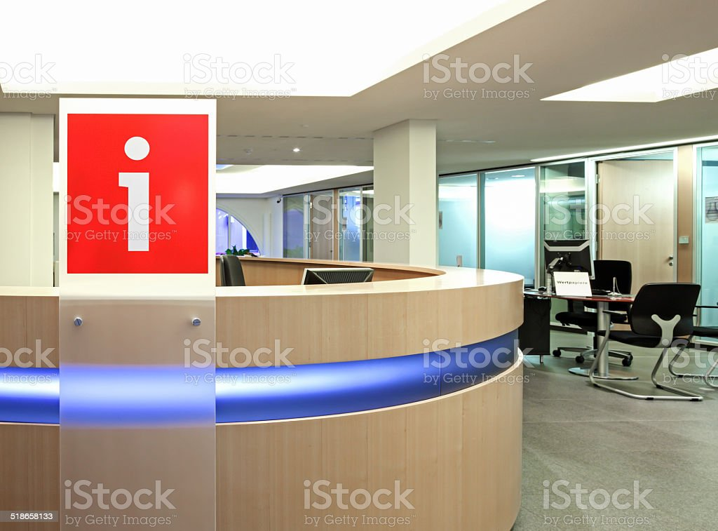 Information point in office building with red plastic sign 'i' stock photo