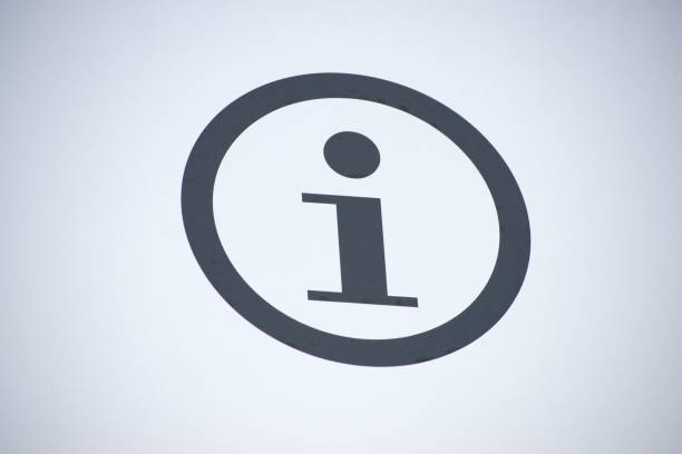 Information symbol Information symbol on a wall of gray. information sign stock pictures, royalty-free photos & images