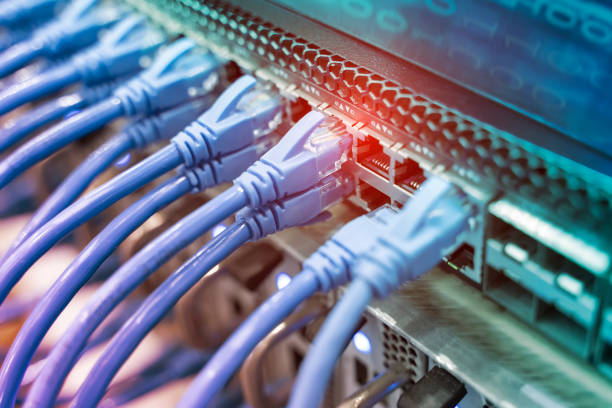 Information Technology Computer Network, Telecommunication Ethernet Cables Connected to Switch. stock photo