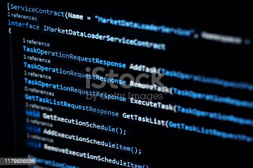 istock Information technology concept. Coding programmer language script text on screen monitor display. Programmer occupation job. Selective focus 1179656538