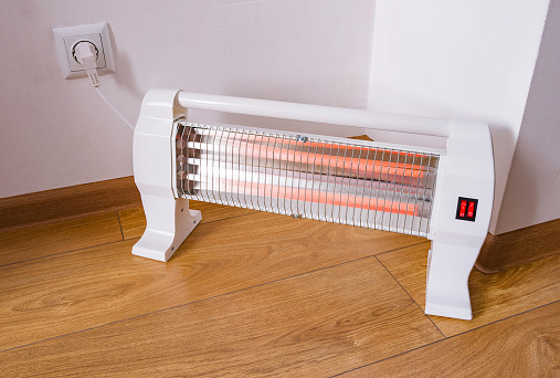 Infrared halogen electric heater at home