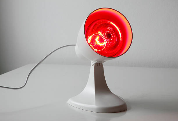 Infrared lamp Medicinal red-light-lamp standing on a table irradiation stock pictures, royalty-free photos & images
