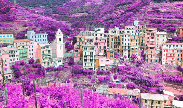 infrared landscape of Manarola village Cinque Terre Italy stock photo