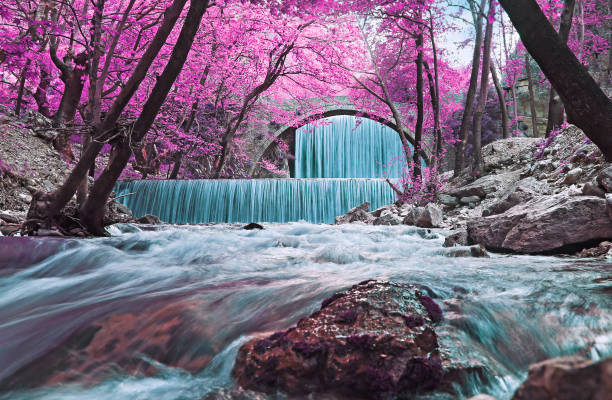 infrared landscape of the double waterfalls Trikala Thessaly Greece stock photo