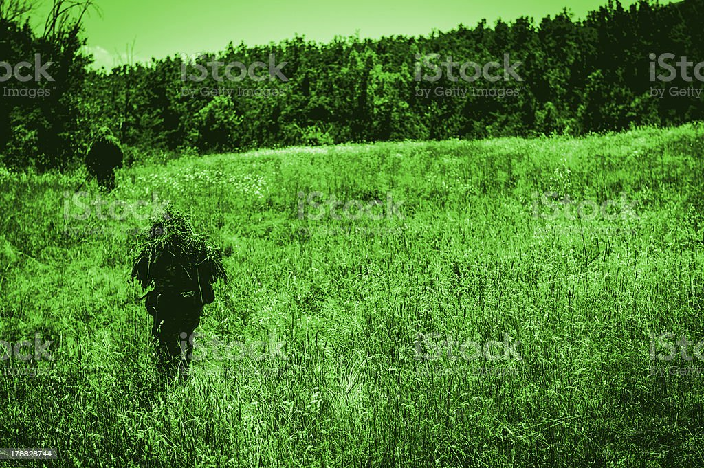 Infrared Night Shot of Sniper and Spotter Soldiers Patrolling stock photo