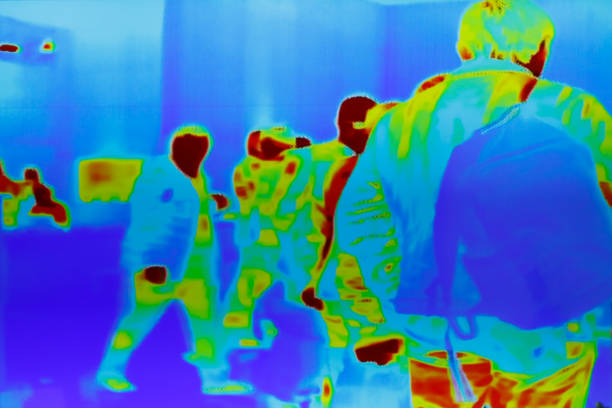 infrared thermal image of a group of passengers Infrared thermal image of a group of passengers at security control. air transport building stock pictures, royalty-free photos & images