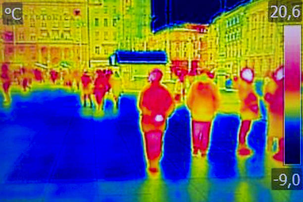 Infrared Thermal image people walking the city streets stock photo