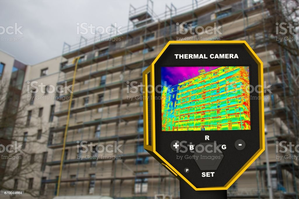 infrared thermal imager showing building facade and window heat loss stock photo